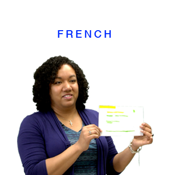 French section with teacher holding assessment tool