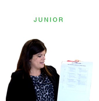 Junior section with teacher holding assessment tool