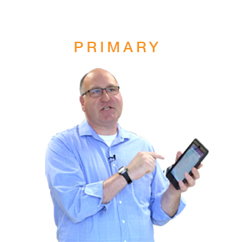Primary section with teacher holding iPad in hand